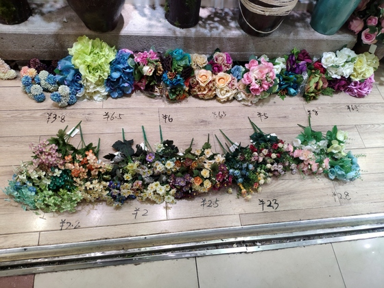 1 supplier inside Yiwu artificial flowers market has some stock, ready to be shipped. MOQ is only 1 carton