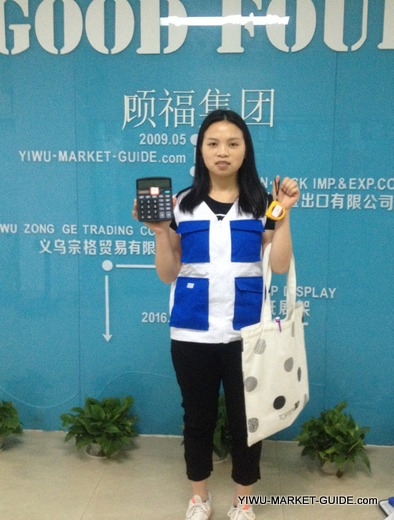 professional guide / translator in Yiwu market with calculator, tape measure, scale... and many more