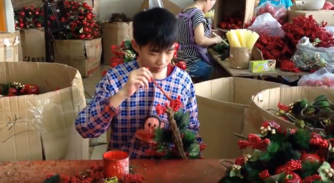 Christmas wreach are made in a factory near Yiwu. By Tim Maughan, 2014