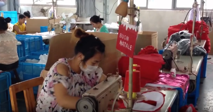 Christmas hats are made in a factory near Yiwu. By Tim Maughan, 2014