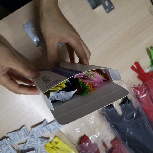 Repack zippers set into box