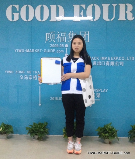 professional guide / translator in Yiwu market with a white board