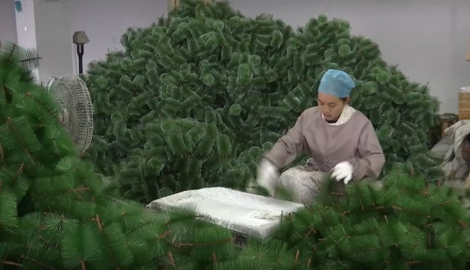 A worker is making Christmas tree in factory, Yiwu, China